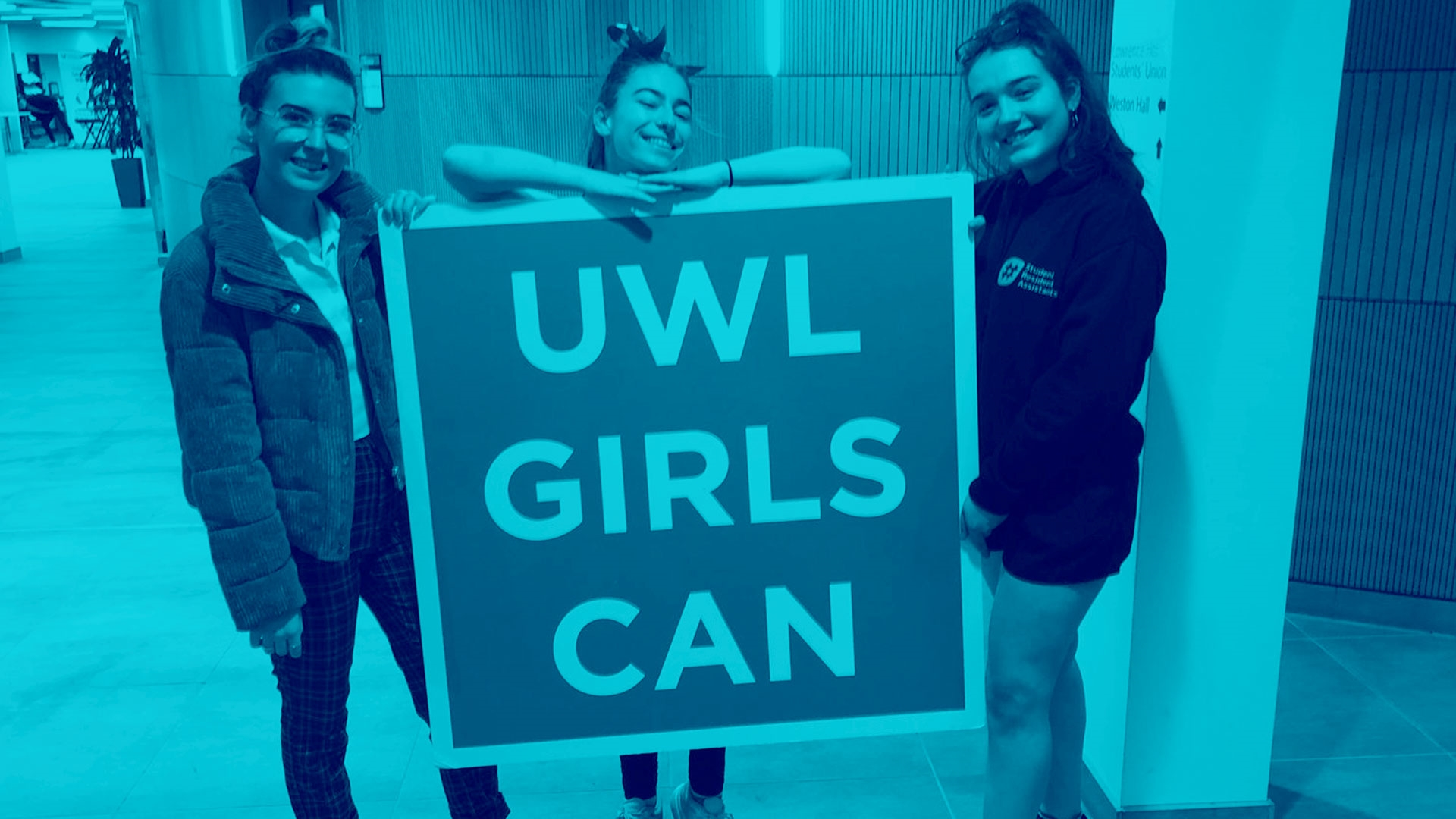 Student Group holding UWL Girls Can sign